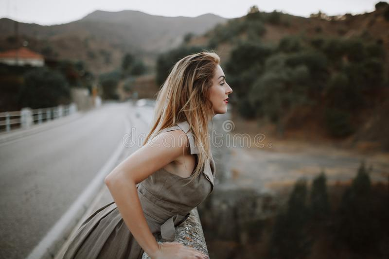 Woman looking nature from a bridge. stock photo