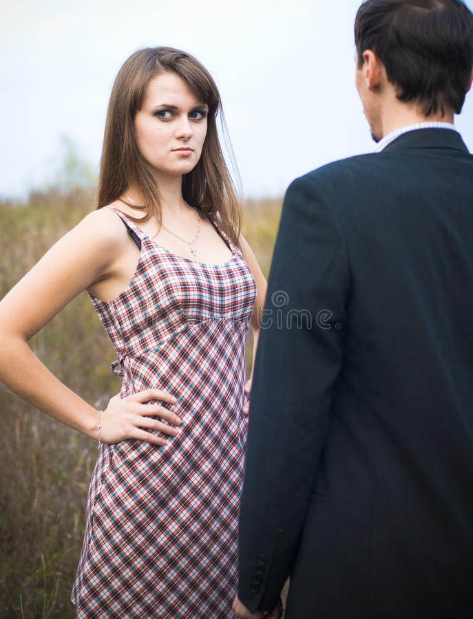 Free Woman Looking Offended Over Man Shoulder Royalty Free Stock Image - 21569866