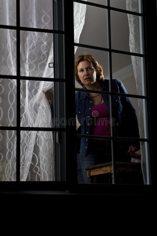 Woman looking out stock photos
