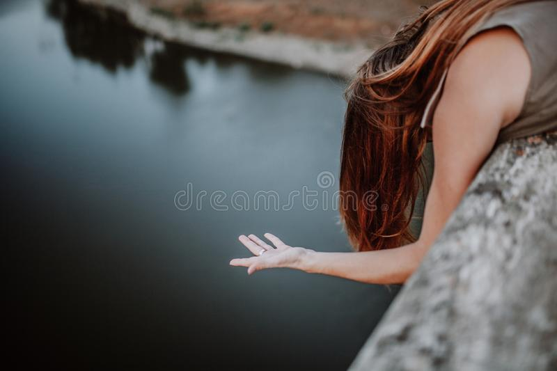 Woman suspending the hand in the air. stock photography