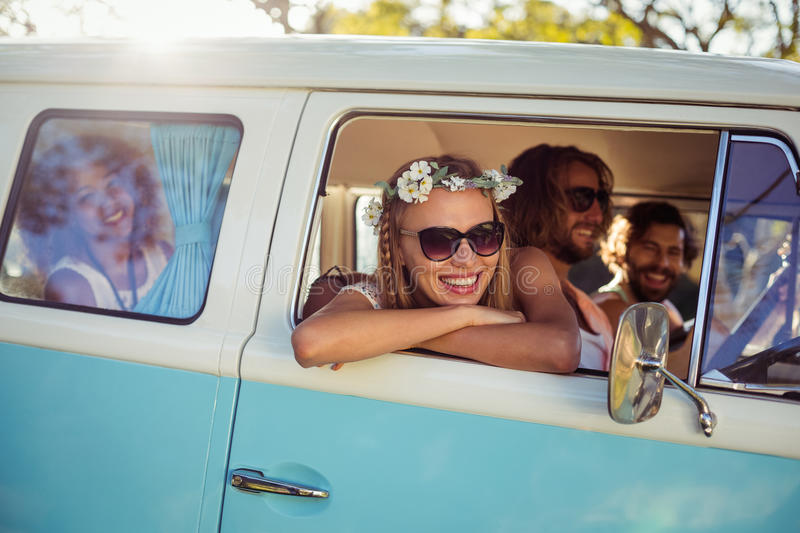 Woman looking out of camper van window royalty free stock images