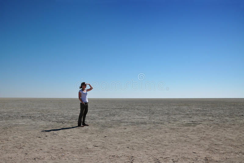 Download Woman Looking Out Over Etosha Pan Stock Photo - Image: 15761350