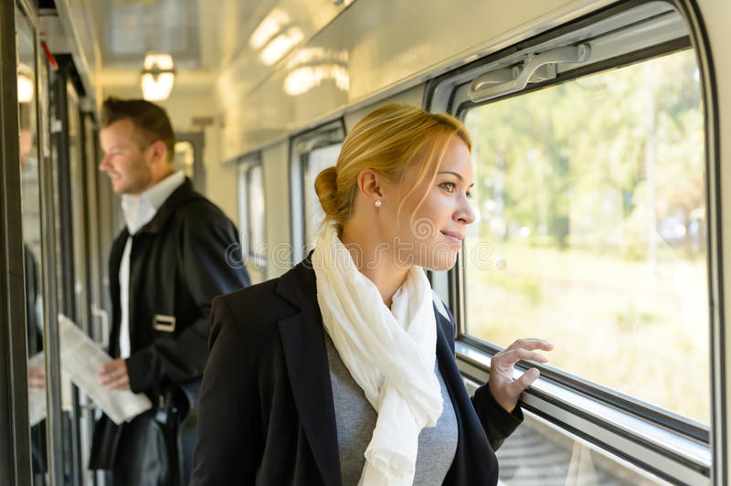 Woman looking out the train window traveling stock image