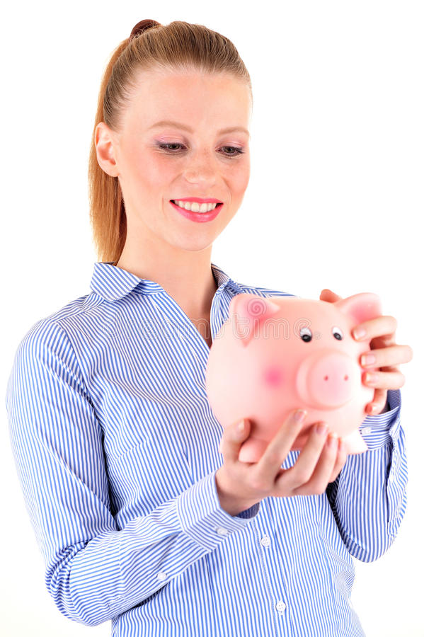 Woman looking at a piggy bank stock images