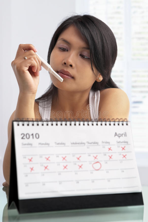 Woman looking at pregnancy test royalty free stock photos