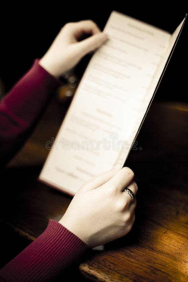 Woman Looking at Pub Menu stock images