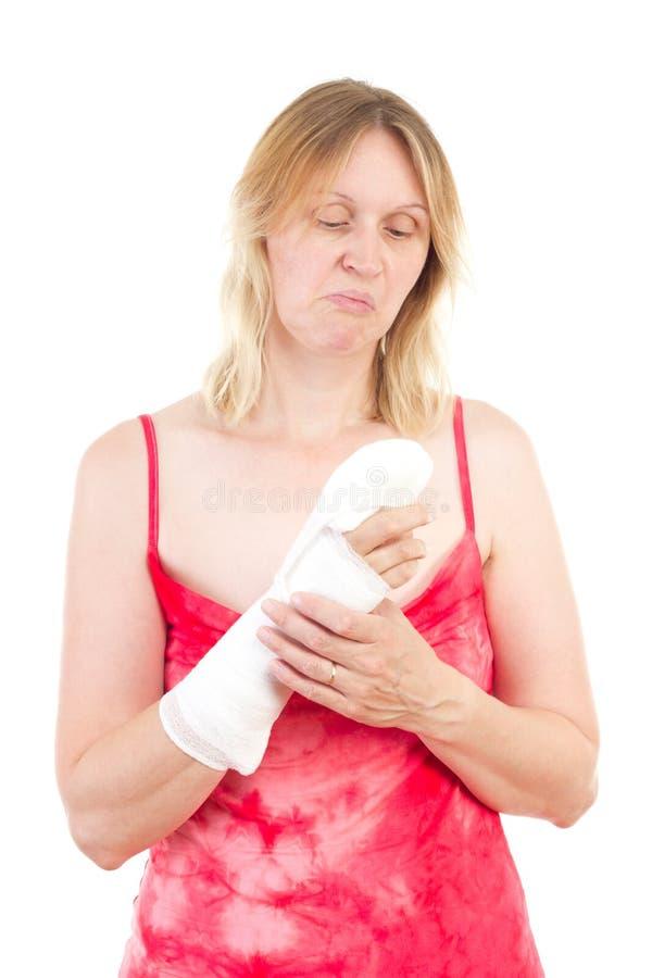 Download Woman Looking Sad At Her Bandaged Finger Stock Image - Image: 32867743