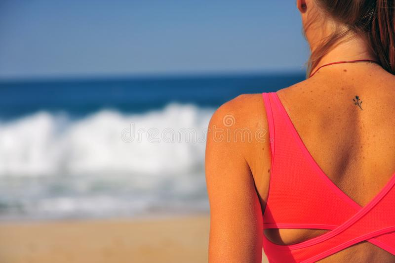 Woman looking at sea in summer day. Woman looking at the sea in summer day stock photo