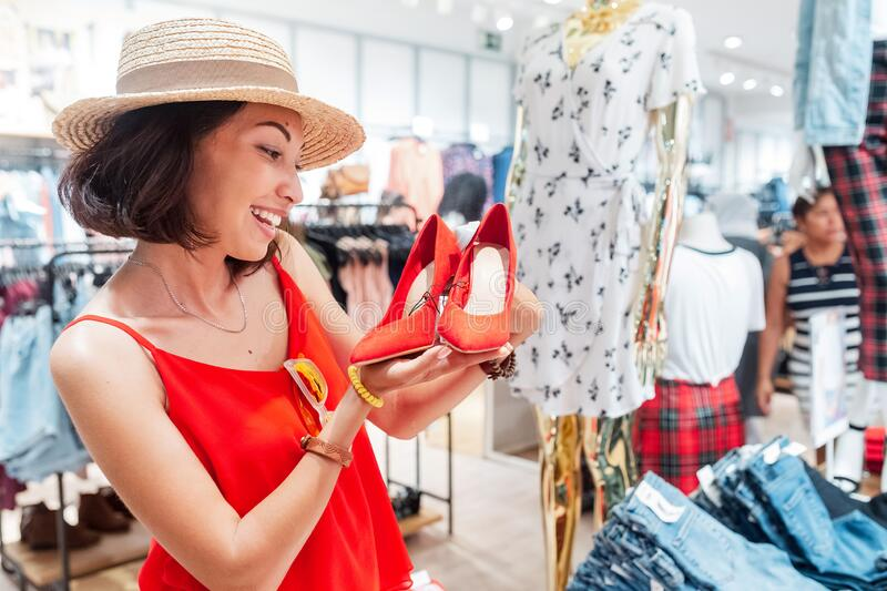 Looking for shoes in shopping mall. Woman looking for shoes in shopping mall stock photos
