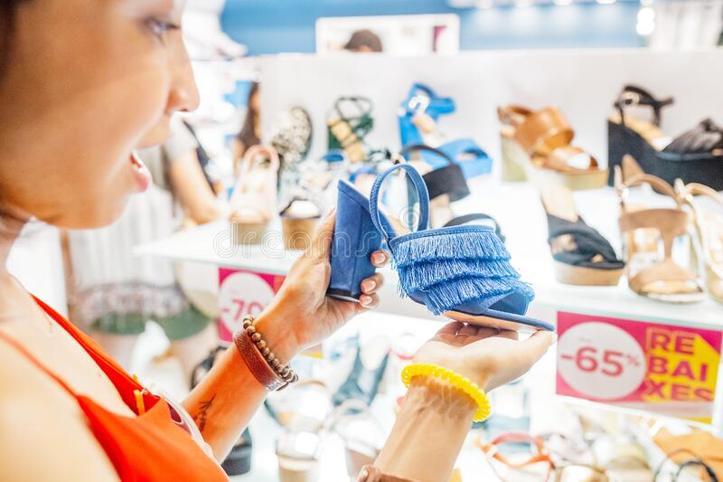 Looking for shoes in shopping mall. Caption: Rebaixes - Sales. Woman looking for shoes in shopping mall. Caption: Rebaixes - Sales royalty free stock photography