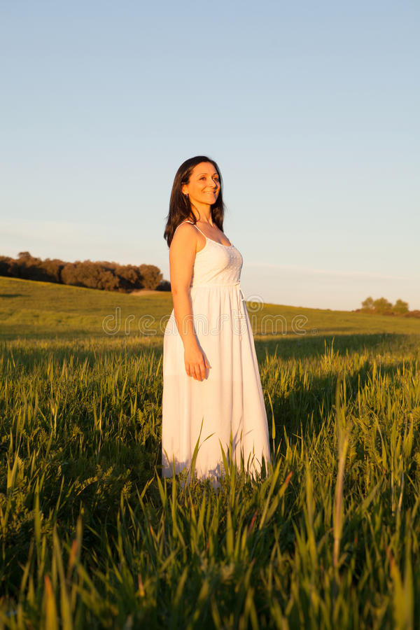 Woman looking at side relaxing on a meadow royalty free stock photography