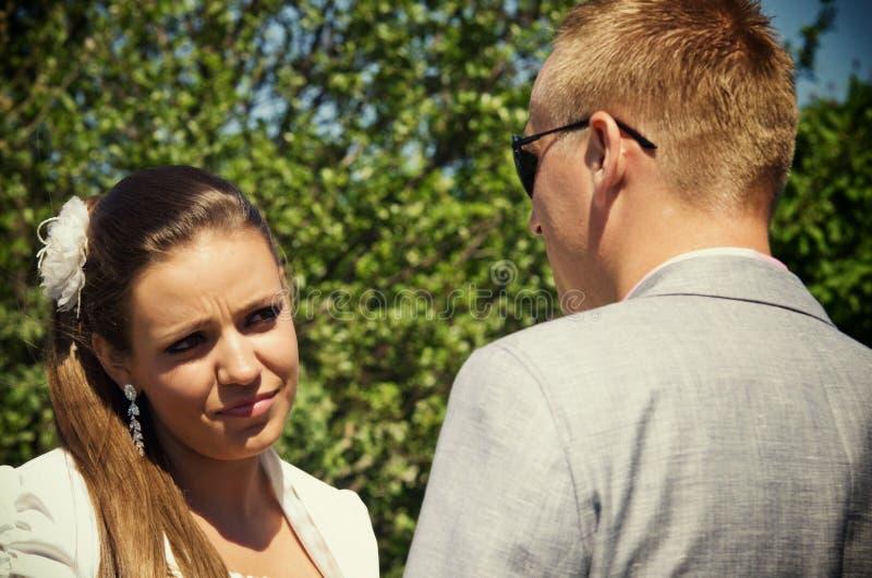 Woman looking skeptically at partner royalty free stock photography