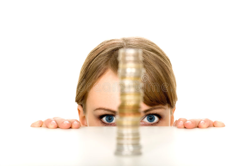 Woman looking at stack of coins stock image