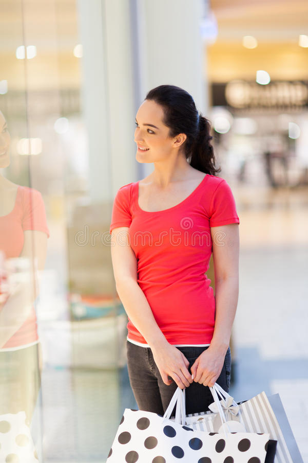 Woman looking store showcase stock image