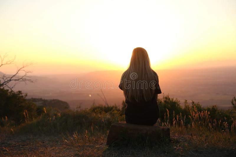 Woman Looking at Sunset royalty free stock image