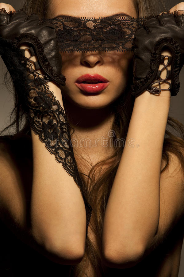 Free Woman Looking Through Black Openwork Lace Stock Photography - 19229492