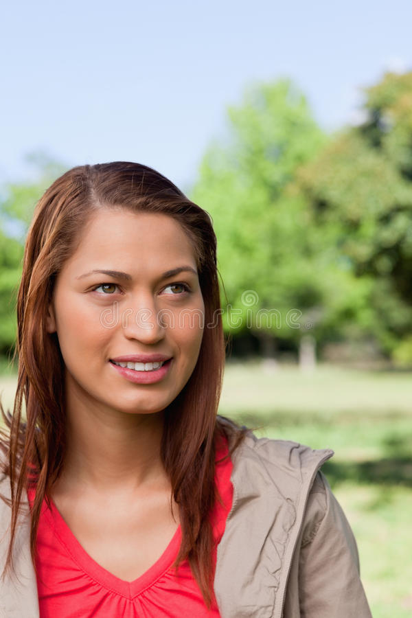 Download Woman Looking Towards The Sky With The Sun Shining Stock Photo - Image: 25332036