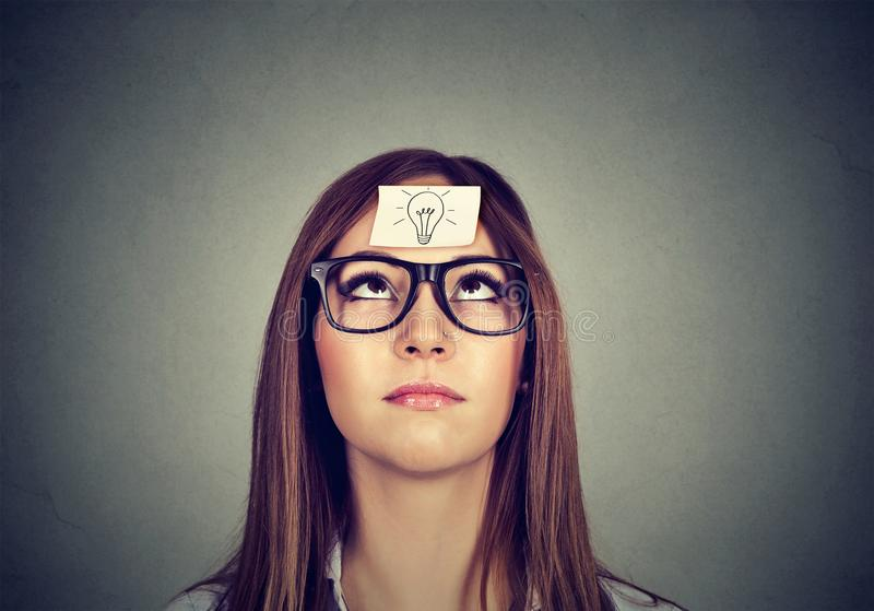 Woman looking up in search of idea royalty free stock images