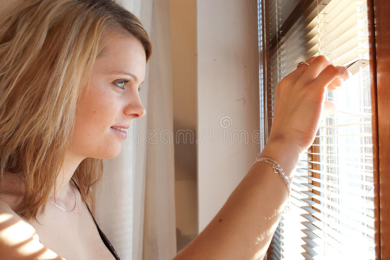 Download Woman Looking Through Window Stock Image - Image: 22053409