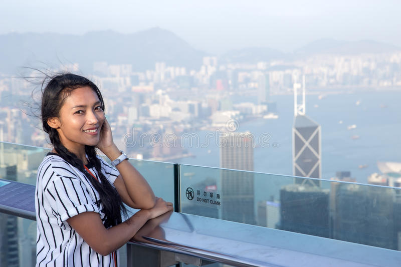Woman on the lookout over Hong Kong royalty free stock photos