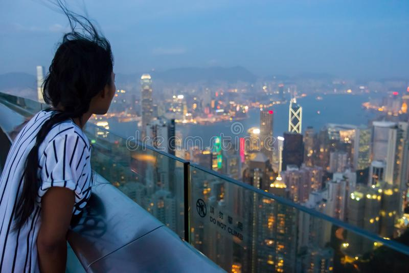 Woman on the lookout over Hong Kong stock image
