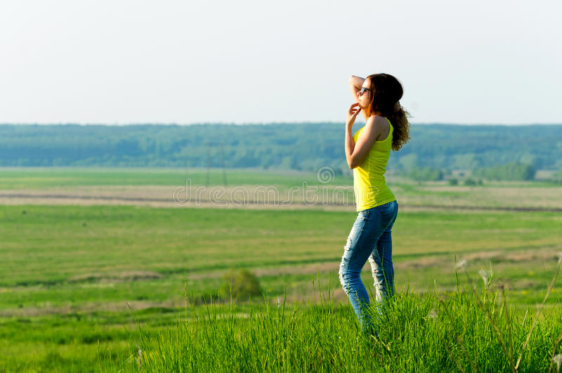 Woman looks into the distance outdoors royalty free stock photography
