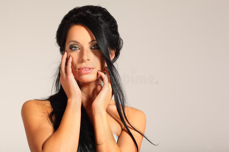 Download Woman Looks Inscrutable And Touching Her Face Royalty Free Stock Image - Image: 22312376