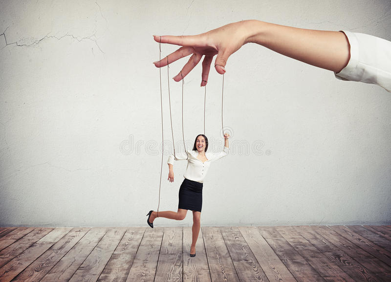 Woman looks like a puppet on strings royalty free stock image