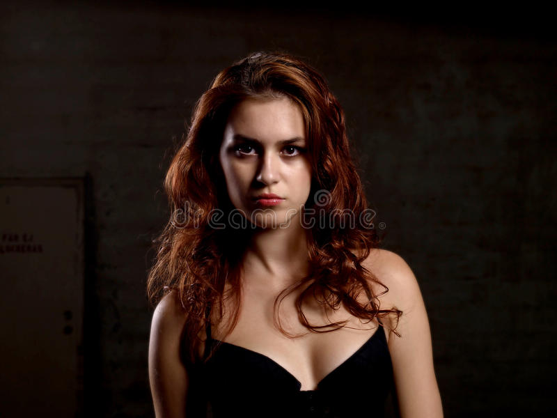 Woman looks serious. Beutiful woman looks serious in studio royalty free stock photo