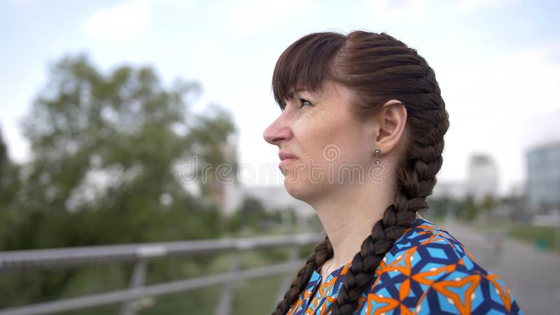 Woman looks at the sky and squints her eyes. Have fun royalty free stock photography