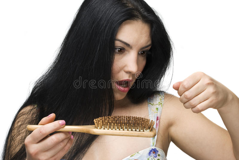 Woman losing hair on hairbrush stock images