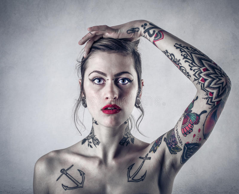 Woman with lots of tattoos stock images