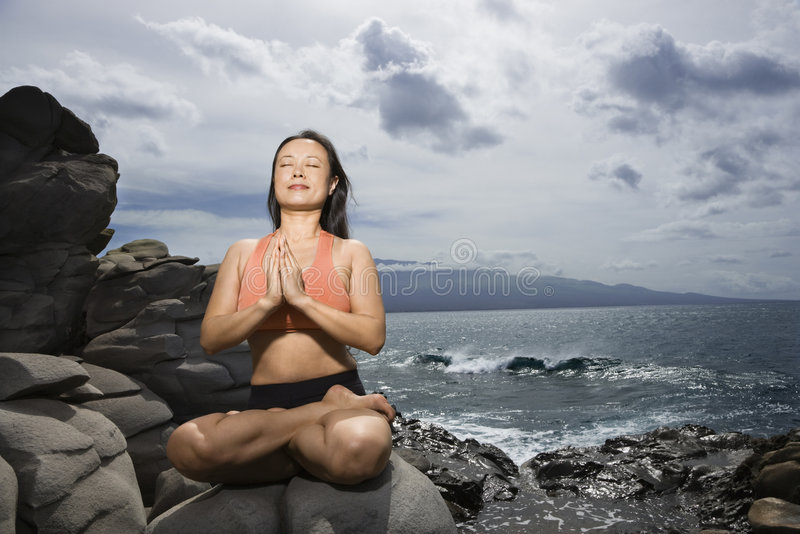 Woman in lotus pose royalty free stock photo