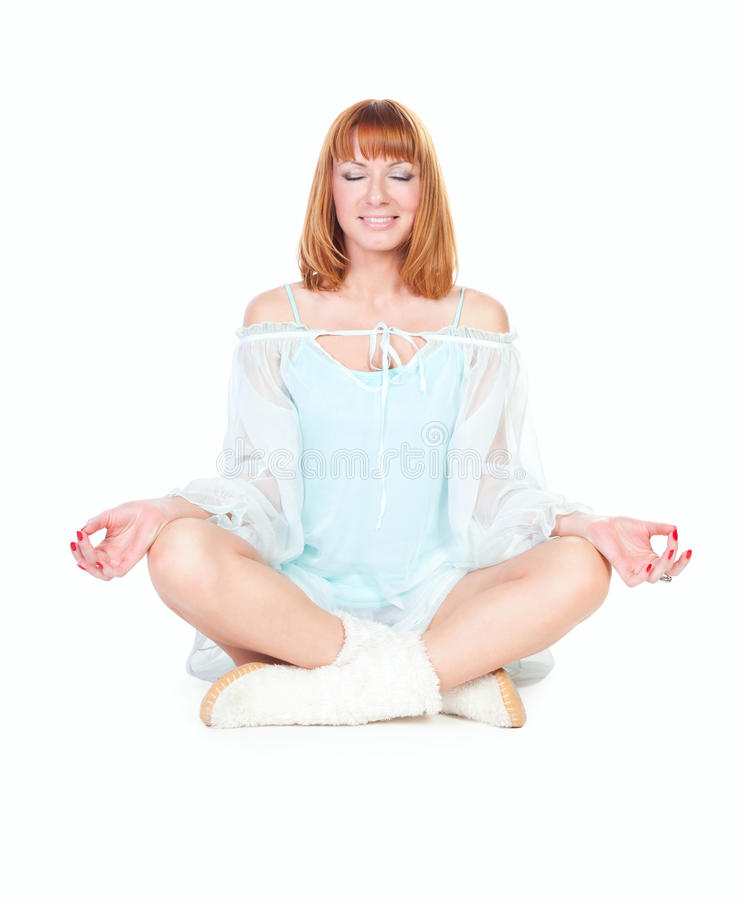 Woman in lotus position sitting on the floor royalty free stock images
