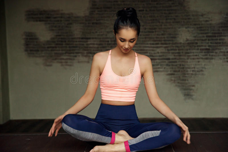 Woman in lotus position stock image