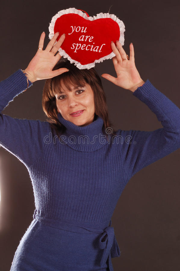 Woman With Love Heart Cushion Stock Image