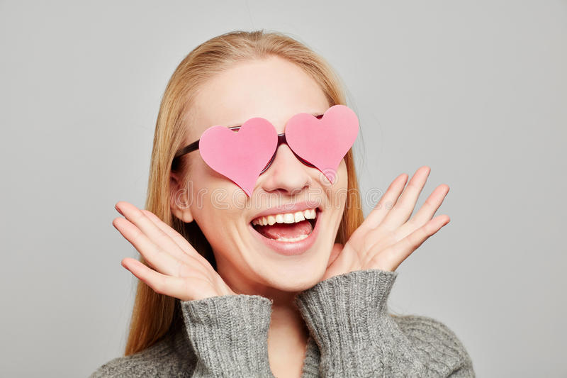 Woman in love with two pink hearts on her eyes stock images