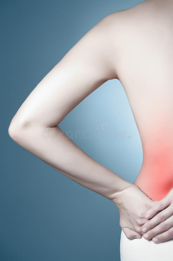 Woman with lower back pain stock photos