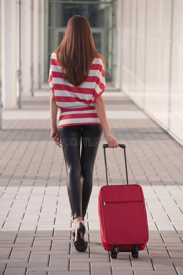 Woman with luggage royalty free stock photos