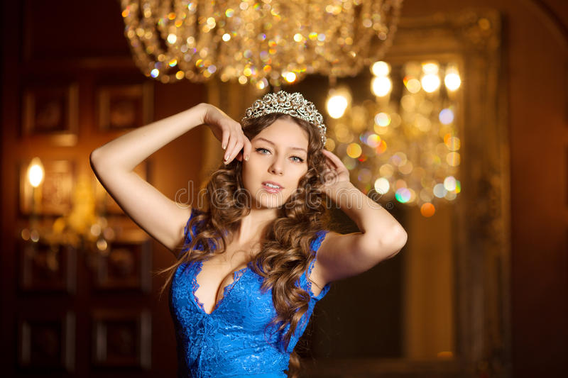 Woman in lux dress with crown like queen, princess, lights party stock images