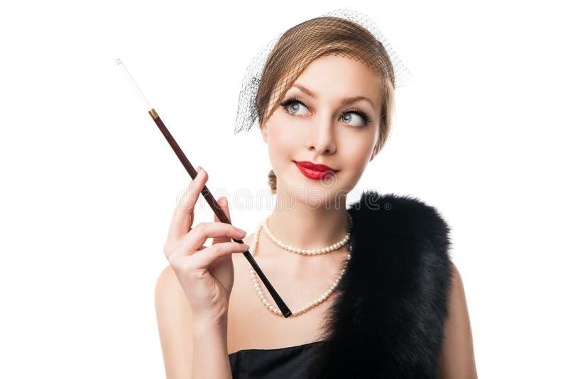 Woman in luxury fur. Retro style. White background stock photos