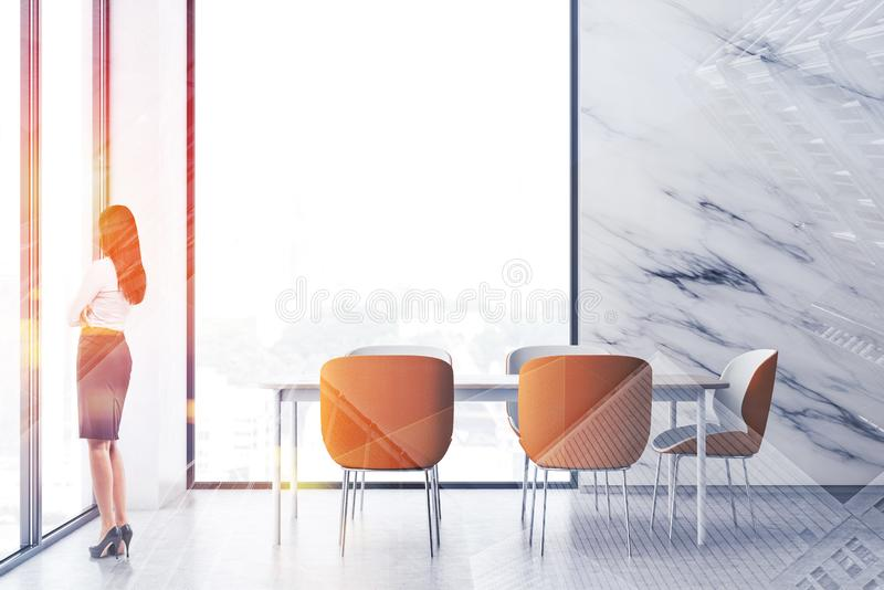 Woman in luxury white dining room stock images