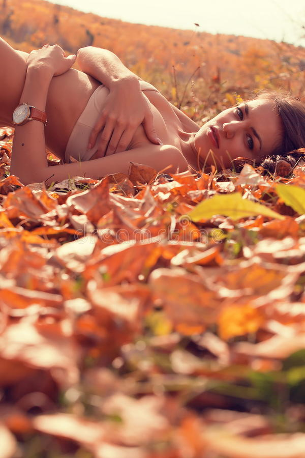 Download Woman Lying In Autumn Forest Stock Photo - Image: 26762752