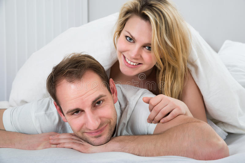 Woman lying on back of man royalty free stock photo