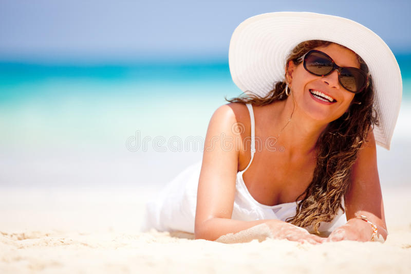 Download Woman lying at the beach stock photo. Image of sand, pretty - 21827310