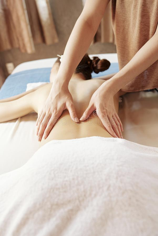 Woman enjoying relaxing back massage royalty free stock photos