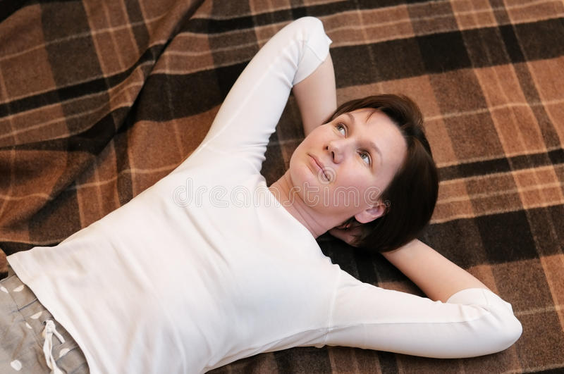 Woman Lying On Blanket Stock Photos