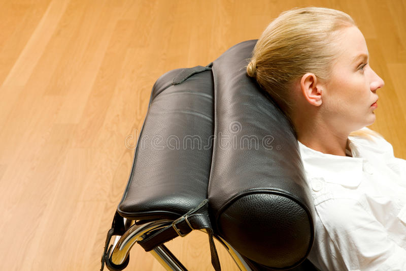 Woman lying on chaise longue stock image