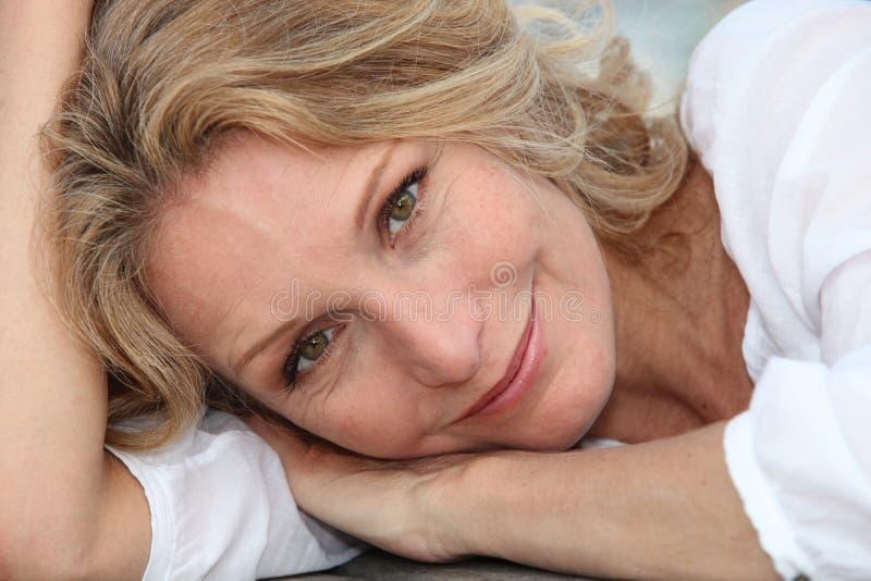 Woman lying down royalty free stock photos