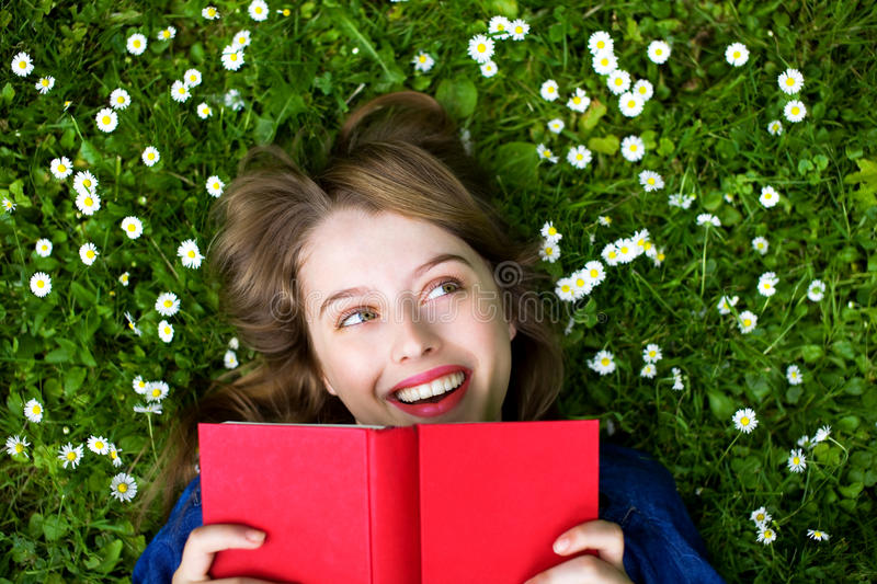 Download Woman Lying On Grass With Book Stock Photo - Image: 14852546